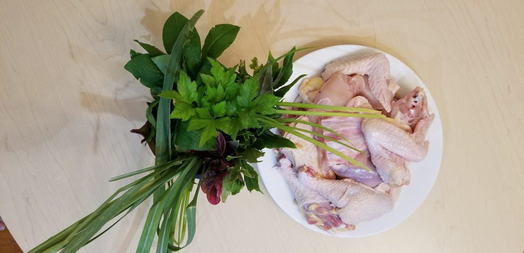 prepped chicken and herbs